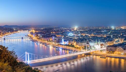 Illuminated City at Night by the Big River
