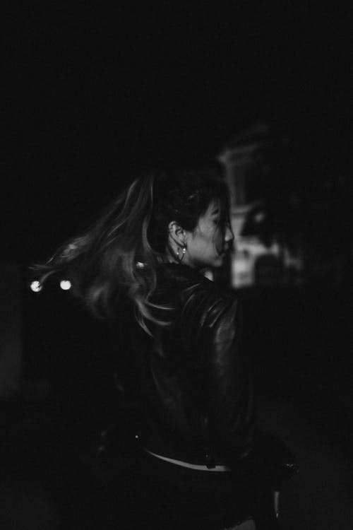 Grayscale Photo of Woman in Black Leather Jacket