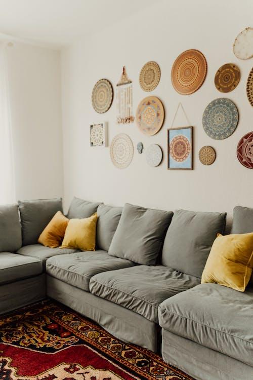Mandala Decors Hanging on Wall near the Gray Sofa