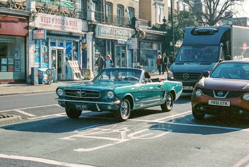 Blue Classic Car on Road