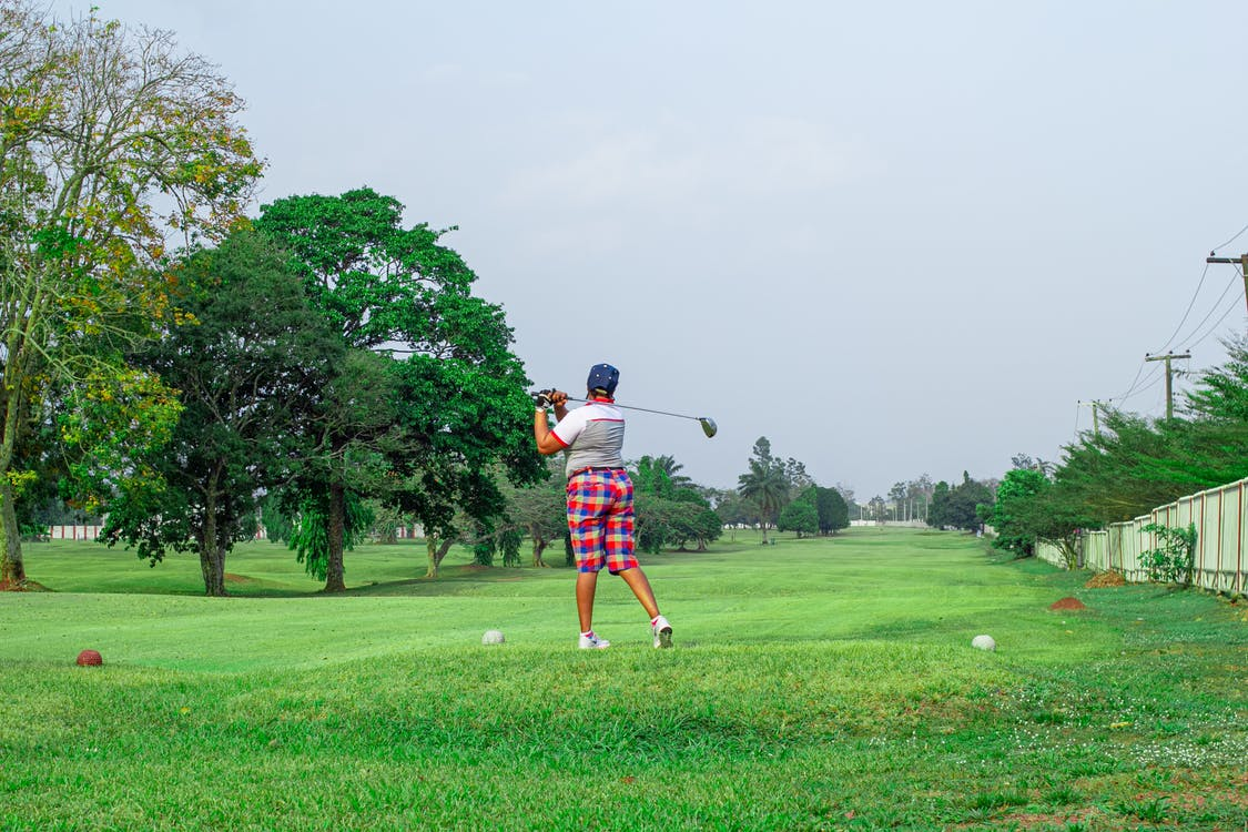Back View of a Person Playing Golf