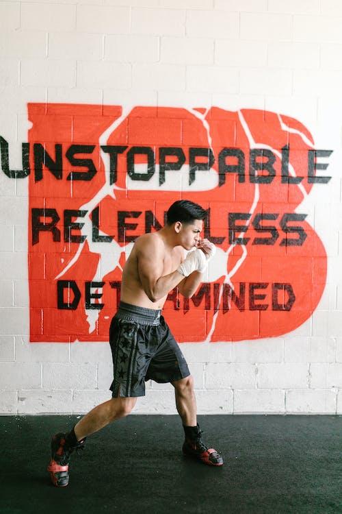 Brawny Man Practicing His Boxing Skills