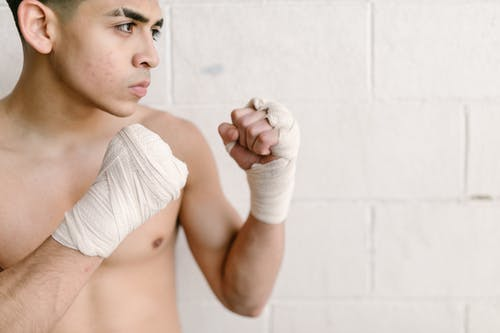 Close-Up Photo of Man Wearing Hand Wraps