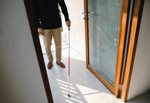 Photo of Person Entering House