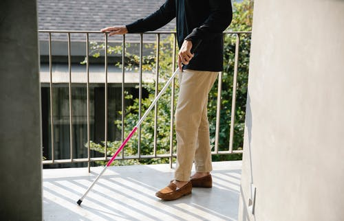 Photo of Person Using Cane for Guidance