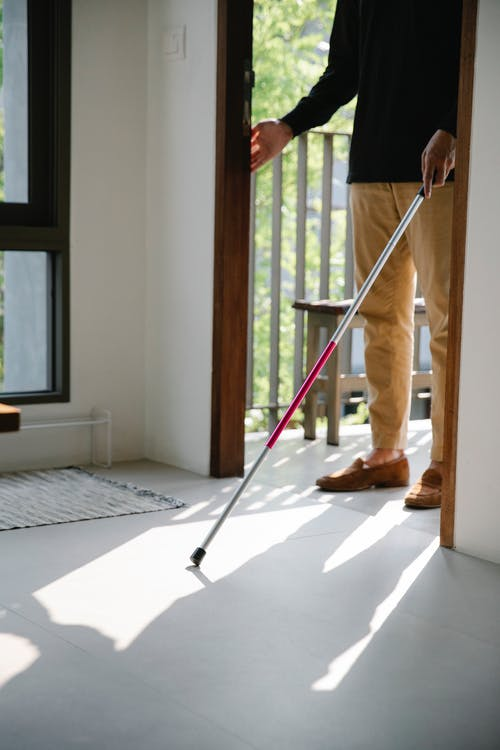 Photo of Person Using Walking Stick as a Guide