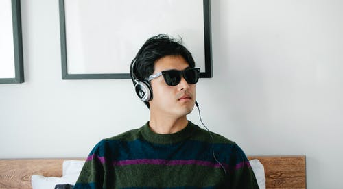 Photo of Man Wearing Black Framed Sunglasses