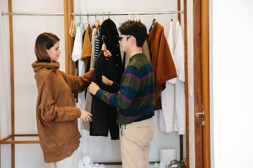 Photo of Man Choosing Clothes