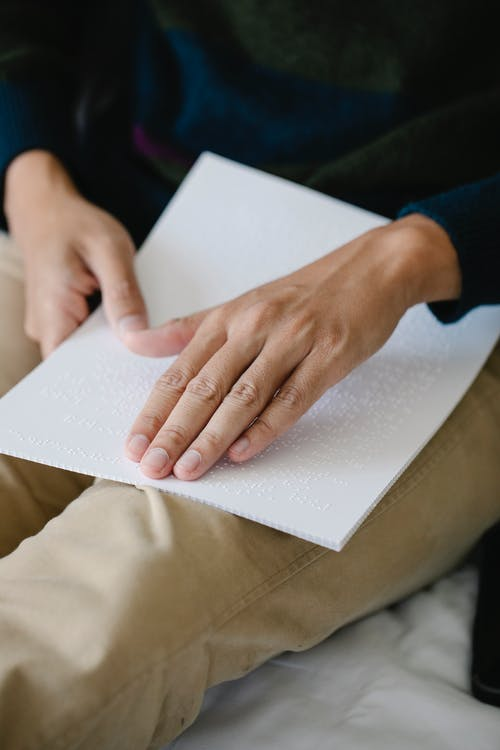 Photo of Person Learning Braille