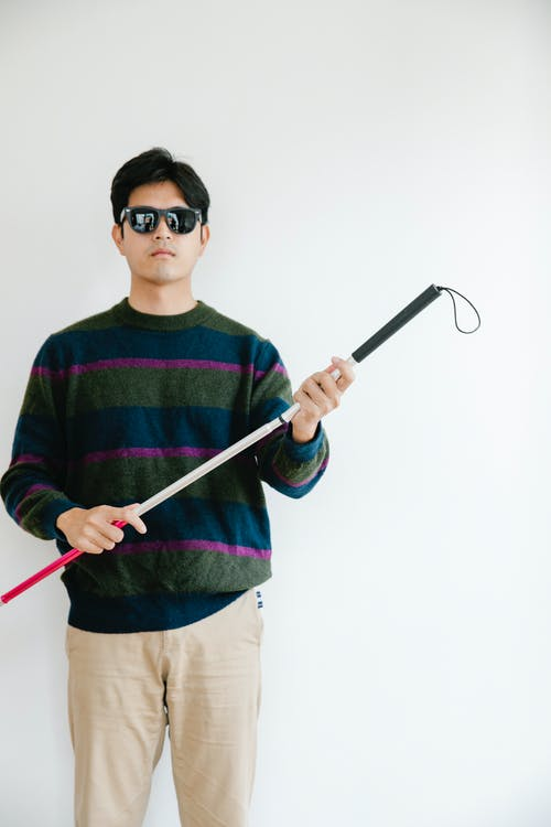 Photo of Man Holding Walking Stick