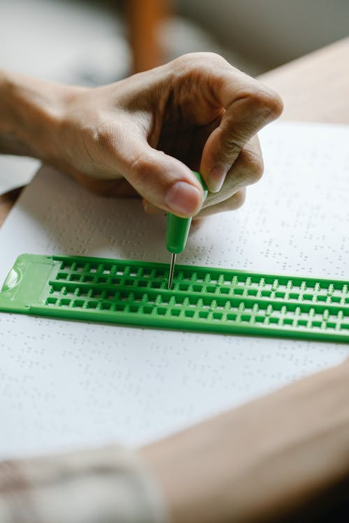 Close-Up Photo of Visually Impaired Writing Materials
