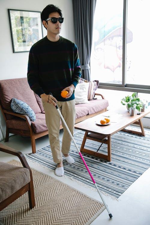 Photo of Man Using Walking Stick for Walking