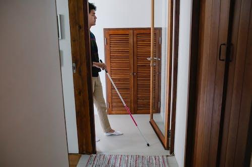 Photo of Man Using Walking Stick