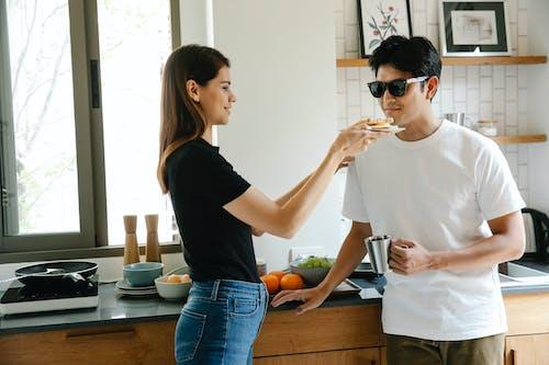 Photo Of Woman Feeding A Man