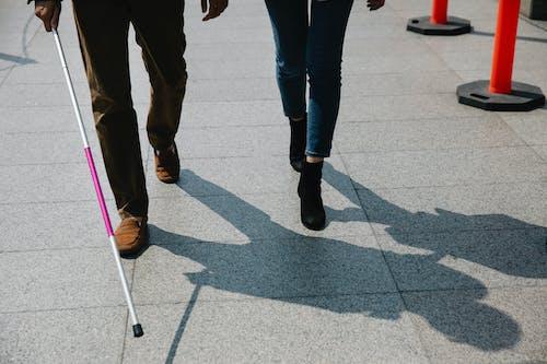Photo of People Walking on Pavement