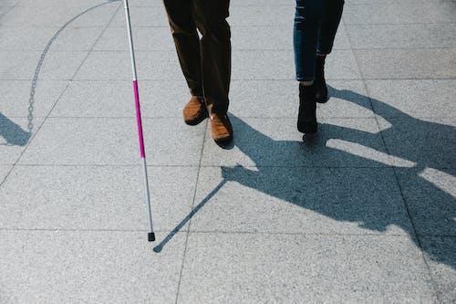 Photo of People Walking on Side Walk