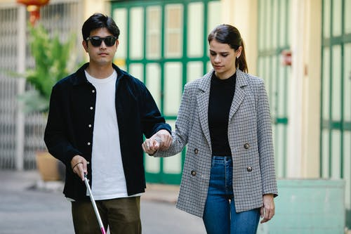 Photo of Woman Assisting A Man