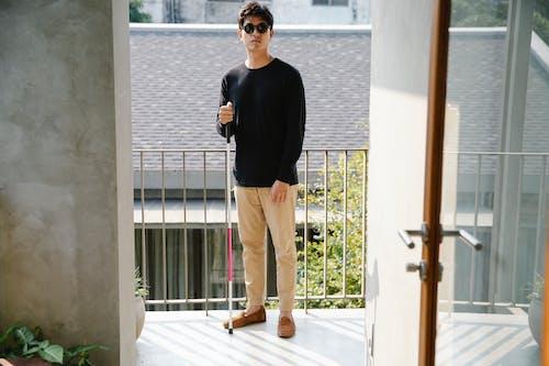 Photo Of Man Wearing Black Sweater