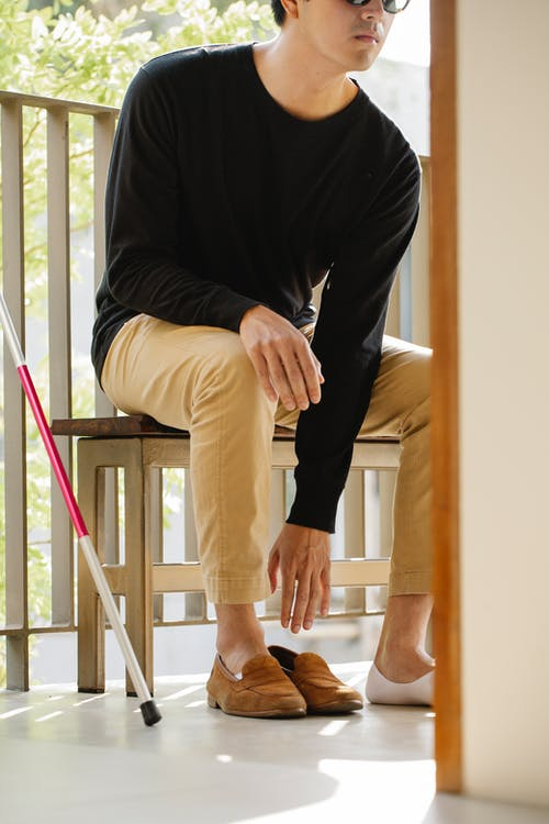 Photo Of Person Wearing Brown Shoes