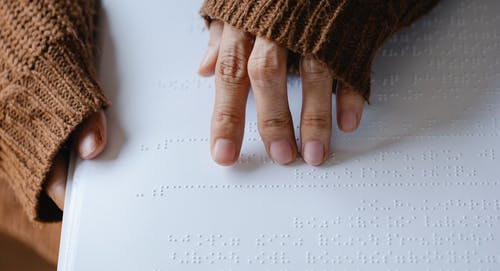 Photo of Person Using Braille