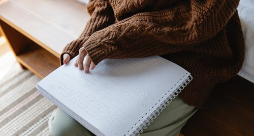 Photo of Woman Using Braille
