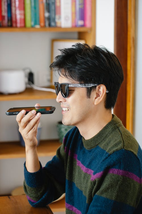 Photo of Man Happily Talking on Phone