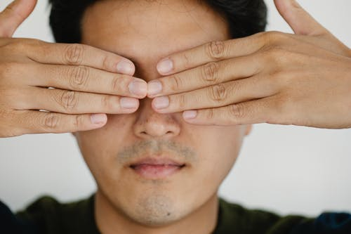 Photo of Man Covering his Face