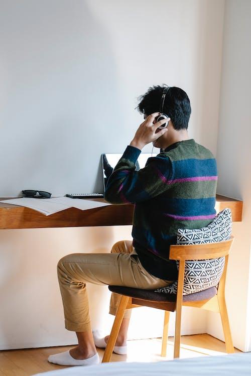 Photo of Man Listening to Music