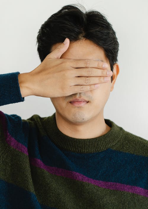 Photo of Man Covering his Eyes
