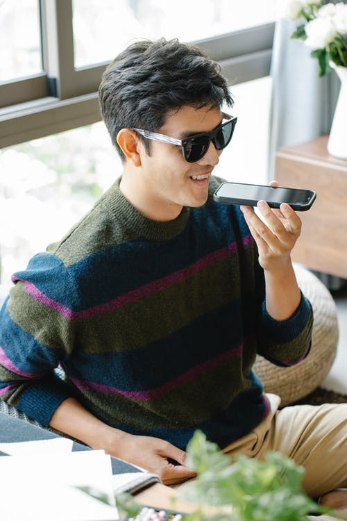Photo of Man in Casual Oufit Talking to the Phone