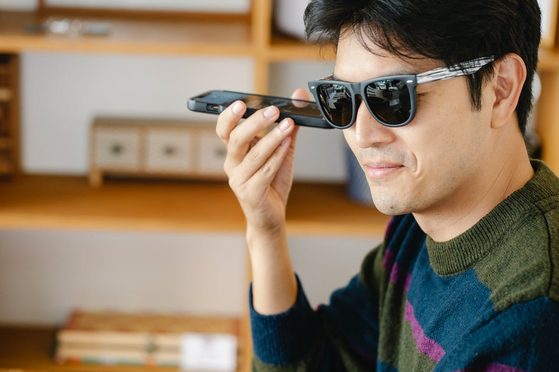 Photo of Man Listening Closely on his Mobile Phone