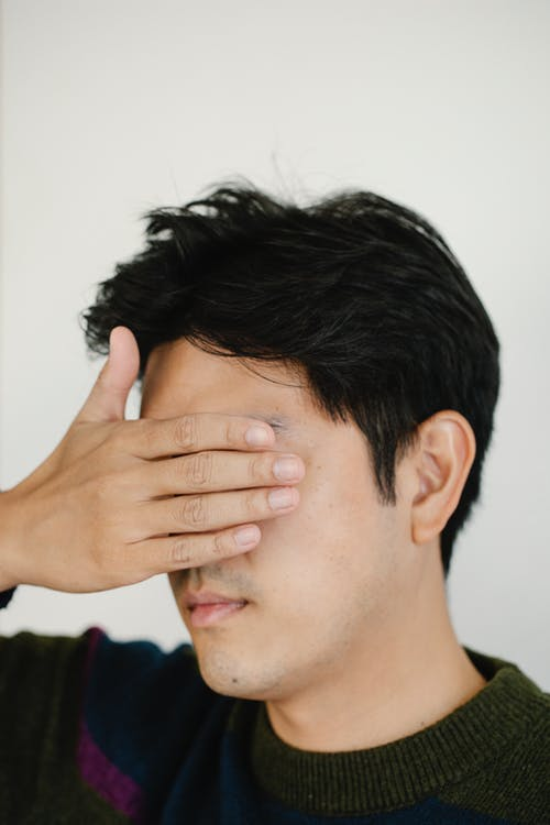 Photo of Portrait Photo of Person Covering his eyes