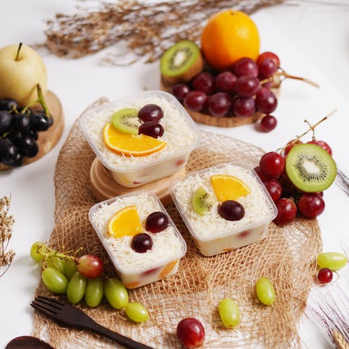 Sliced of Bread With Fruits on Brown Woven Tray