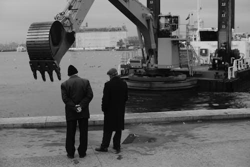 Men Watching an Heavy Machinery