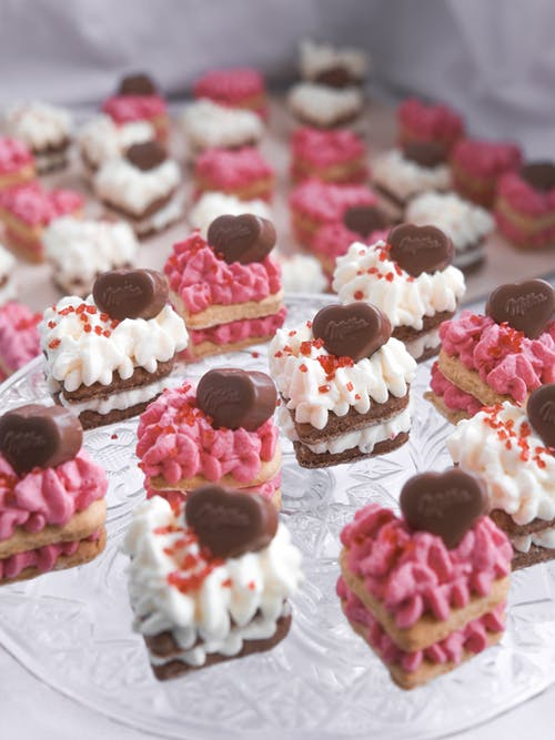White and Pink Cupcakes on Glass Round Plate