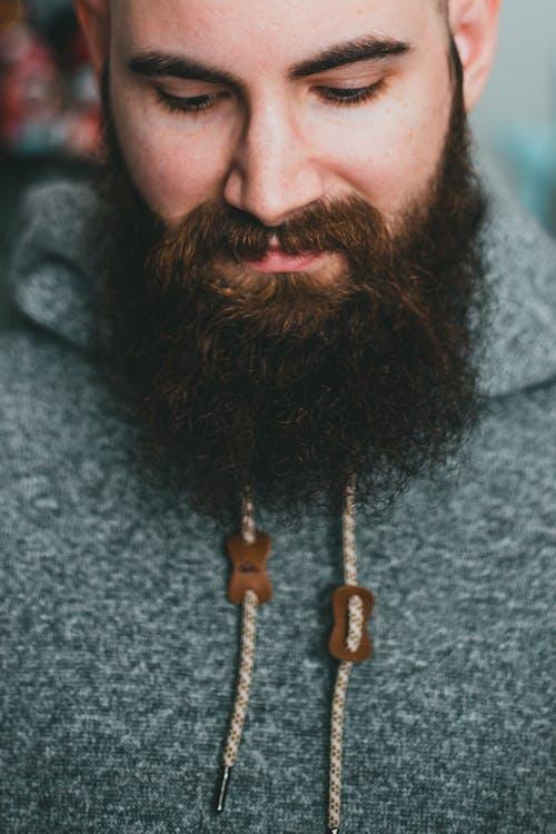 Bearded man in warm gray hoodie