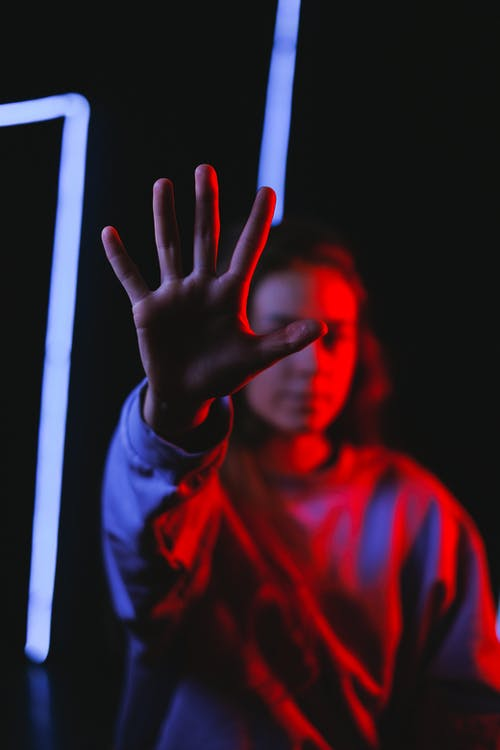 Female reaching out hand in dark room