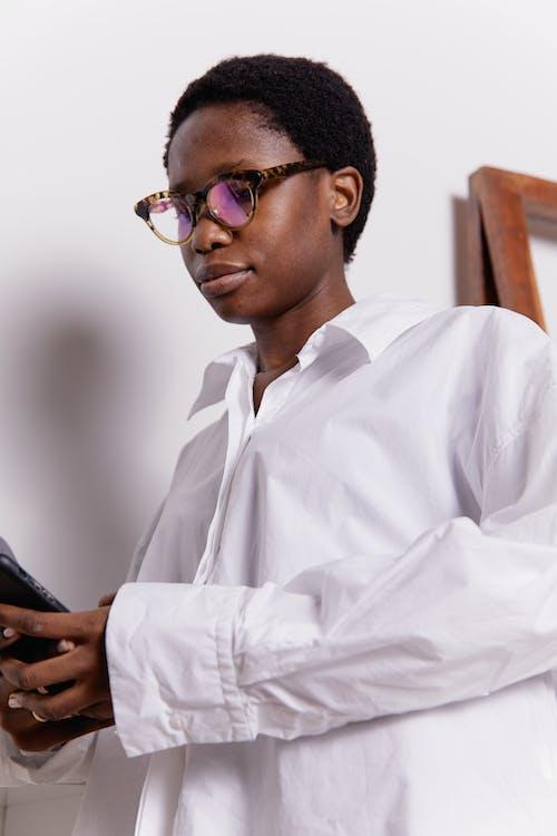 Woman Wearing Eyeglasses using Mobile Phone