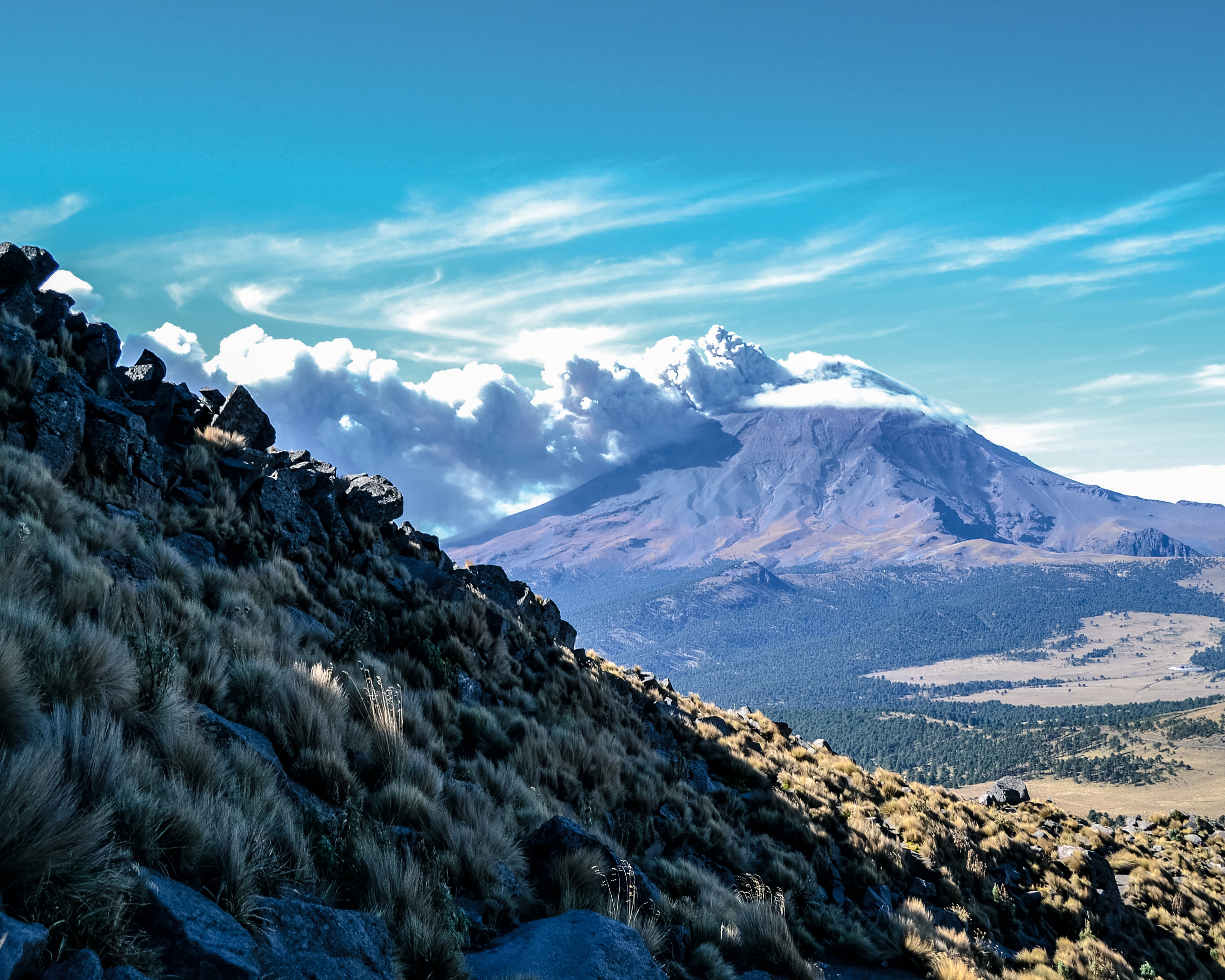 Brown Mountain Under White Clouds and Blue Sky