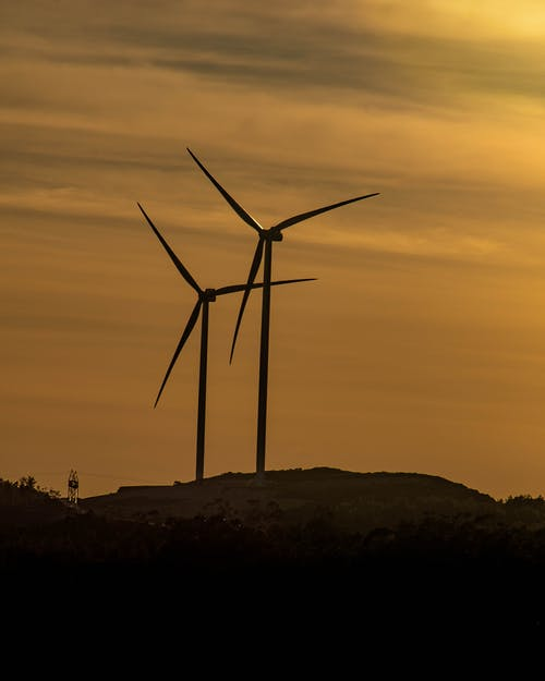 Wind Turbines on Hill during Sunset