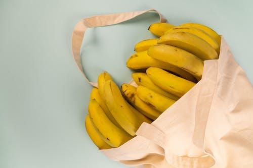 Bundles of fresh bananas in eco friendly bag