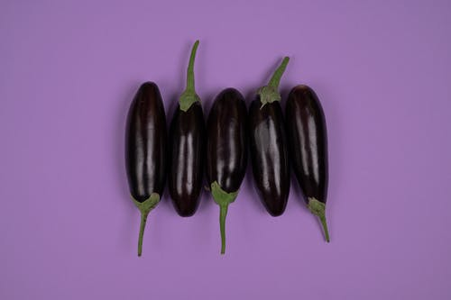 Eggplants on a Purple Surface