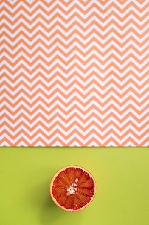 Slice of grapefruit on colorful background