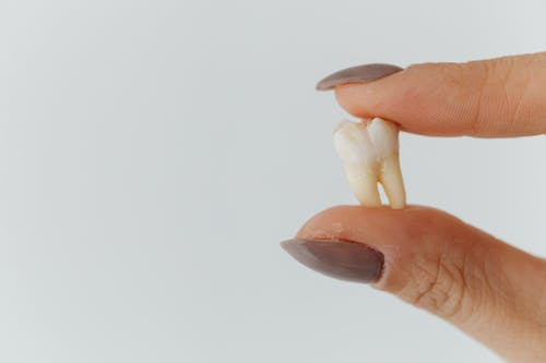 Close-up Shot of a Loose Tooth