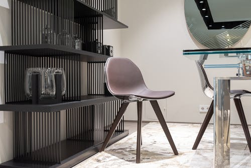 Fragment of stylish interior with chair and table