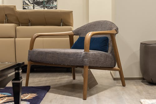 Comfortable armchair with cushion at home