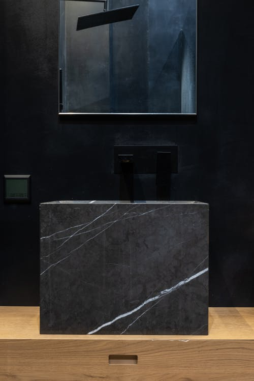 Interior details of contemporary bathroom with marble sink and mirror