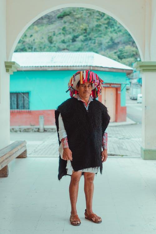 Photo Of Man Wearing Black Poncho