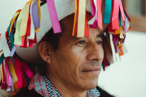 Close-Up Photo Of Man Wearing Traditional Hat