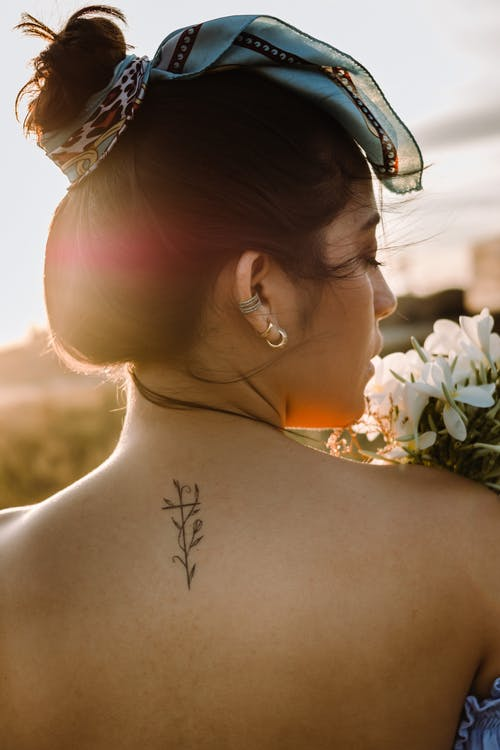 Photo of a Woman's Back with a Tattoo
